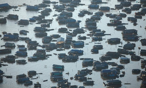 Chong Kneas village, Tonlé Sap, near Siem Reap. Such villages often lack sanitation, with waste deposited directly into the freshwater lake. Photograph: David Wall/Alamy