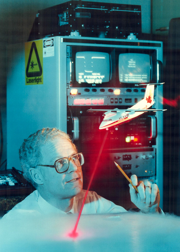 In this 1986 photo, Optech cofounder Allan Carswell considers a model of his company's airborne laser system for mapping coastal waters in the Arctic.