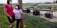 Activists Dawn Chapman, left, and Karen Nickel wear protective masks at the West Lake Landfill in Bridgeton, Mo., north of St. Louis. The site, part of which is listed as among the nation's most toxic messes, includes radioactive waste illegally dumped in the 1970s. (Linda Davidson/The Washington Post)