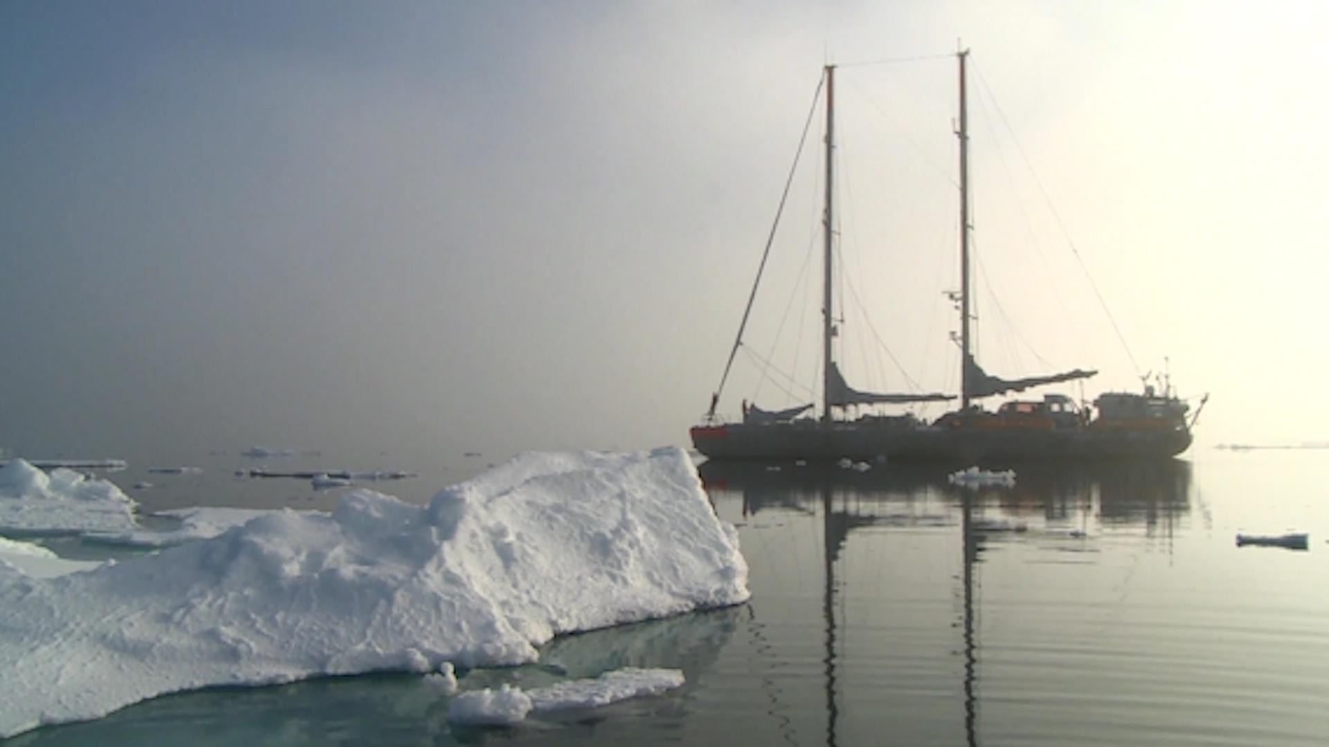 Deserted ship near iceberg